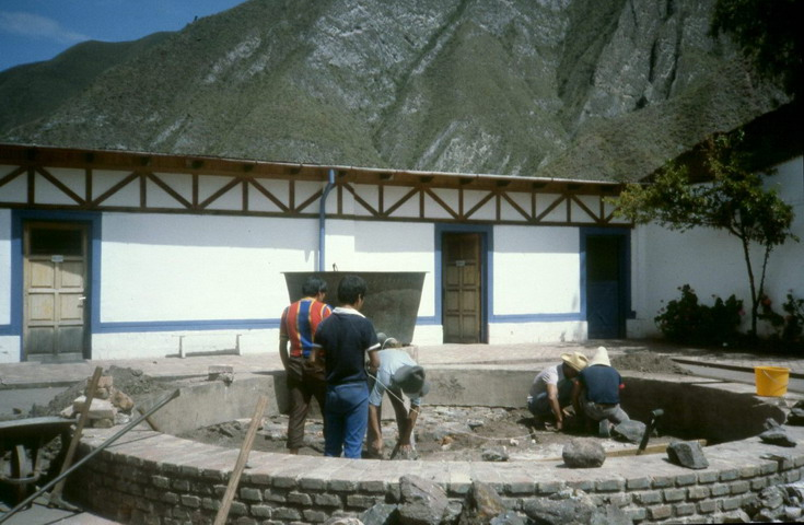The workers renovating the pond